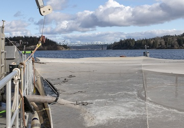 NUWC Keyport, Suquamish Tribe release salmon at Keyport pier