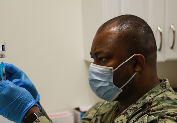 U.S. Army Soldiers and U.S. Navy Sailors aid FEMA in administering COVID-19 vaccine to Somerset community