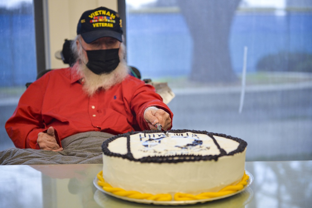 Retired Major Irving Torres-Rivera cuts the cake at commemoration ceremony
