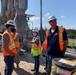 Local media representative talk with contractor at Herbert Hoover dike
