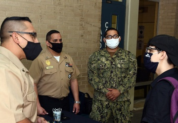 Brothers return to Alma Mater to speak with students about the Navy
