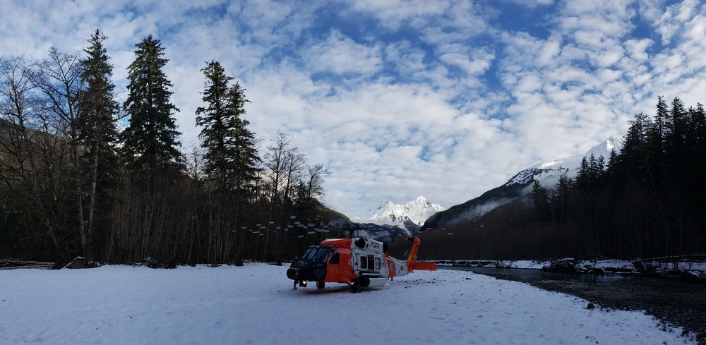 Coast Guard aircrew assists 3 stranded mariners, 2 dogs in the Gilkey River, Sunday
