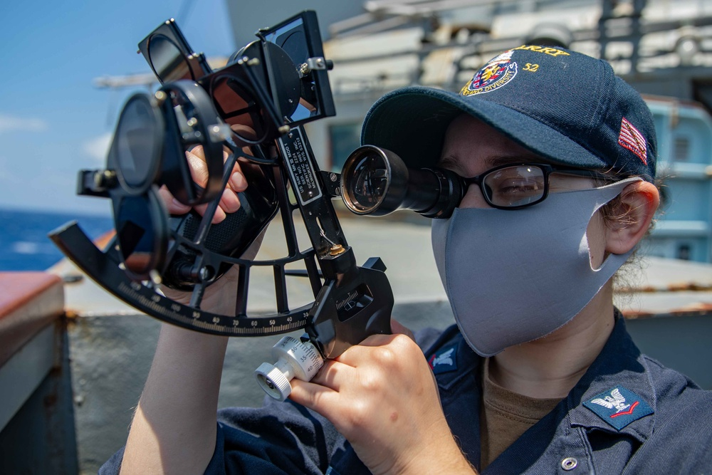 QM3 Rachel Frank takes measurements with a sextant aboard the USS Barry