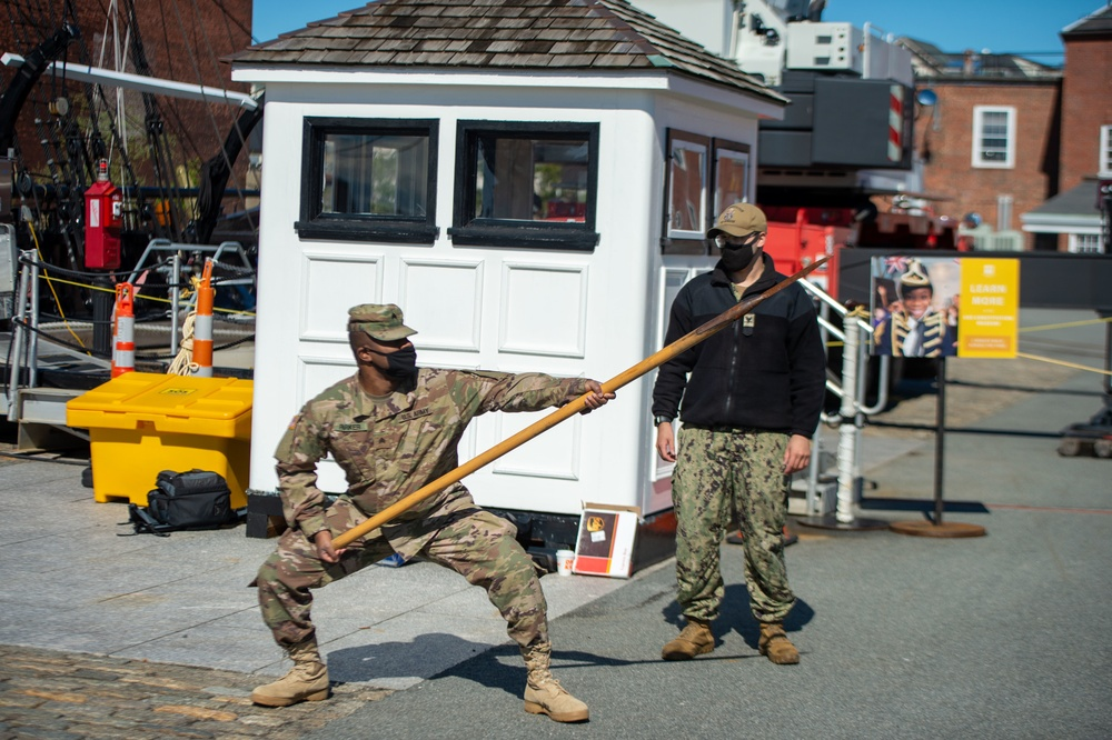 Soldiers from the 826th Military Intelligence Battalion participate in an 1812 naval heritage event, featuring pike drills, gun drills and a tour