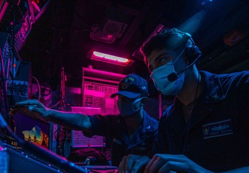 CTT2 Brandon Gibson and CTT3 Isais Zepeda stand the Electronic Warfare Supervisor watch aboard the USS Barry