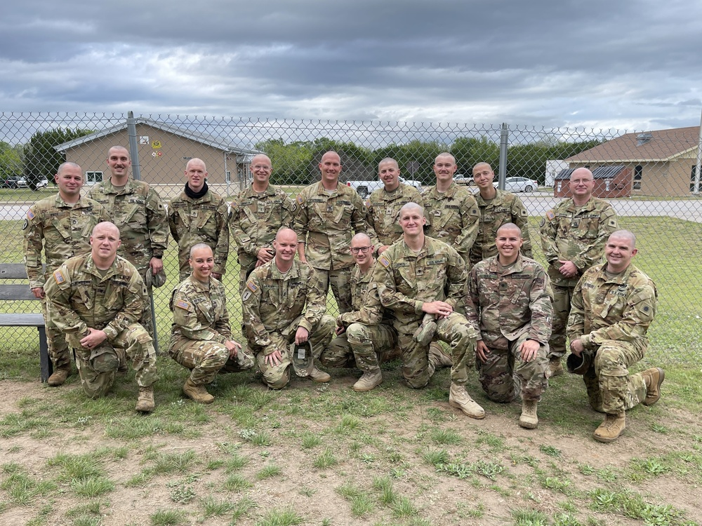Soldiers shave their heads to support battle buddy's sister who is recovering from cancer