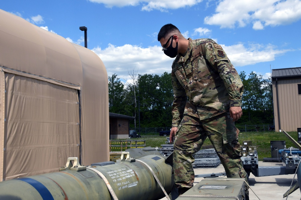 Airman First Class Carlos León secures a load at Joint Base Andrews