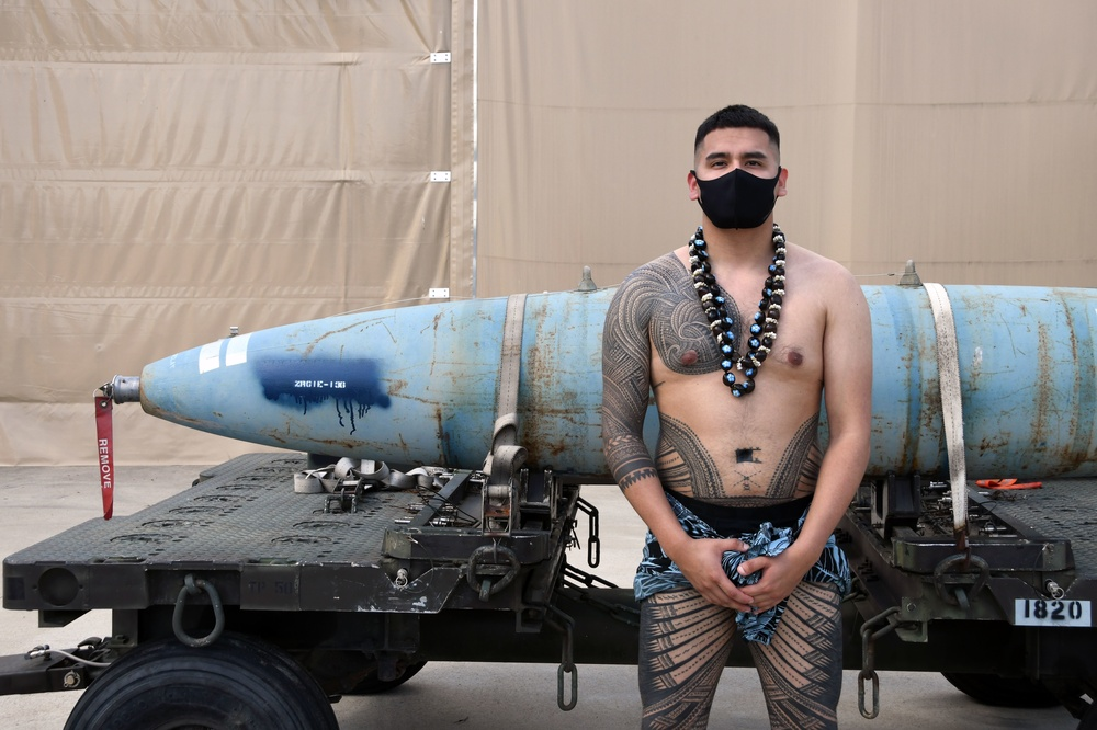 Airman 1st Class Carlos León poses for a photo in traditional Samoan attire