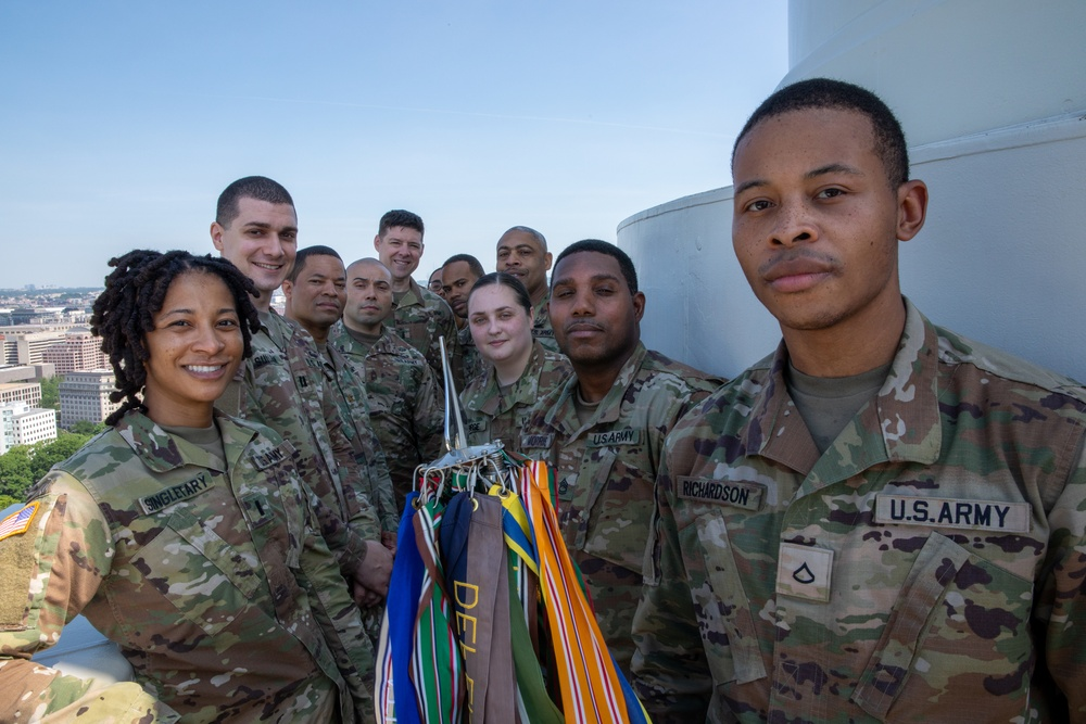 National Guard members pose for a photo at the U.S. Capitol on final day of security mission