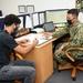 NC1 Marvin Tan Screens a Navy Applicant