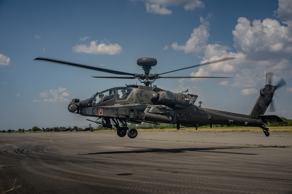 A AH-64D Apache returning from the Live Fire range