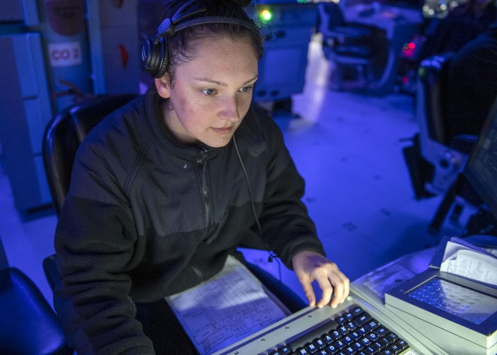 Operations Specialist Seaman Apprentice Abigail Dalton, from Dayton, Ohio, tracks surface contacts