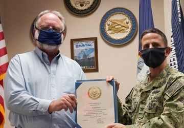 Bryan R. Dewey is Presented a Letter of Appreciation from Capt. Greg Vinci, NAVFAC Washington commanding officer