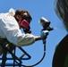 Airmen conduct maintenance on historical aircraft displays