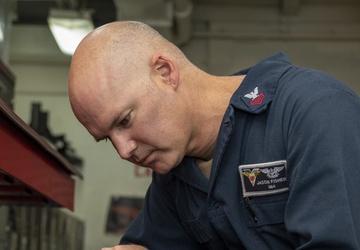 Sailor cleans a Look Ring Aboard USS Carl Vinson (CVN 70)