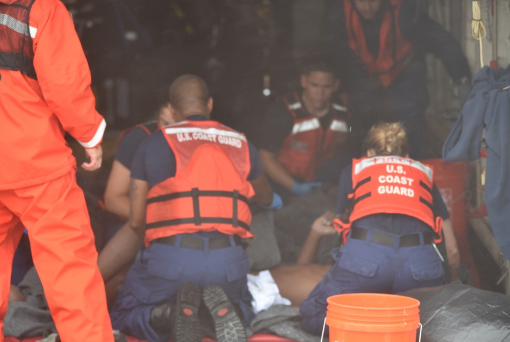 Coast Guard, good Samaritanrescue 13 from water off Key West