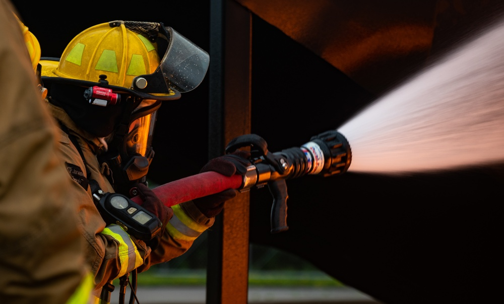 Feel The Burn: 152nd Civil Engineer Squadron firefighters participate in live burn exercise