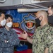 Cmdr. J.J. Murawski (left), commanding officer of USS Rafael Peralta (DDG 115), and Cmdr. Charles Cooper (right), executive officer, meet with officers from the Republic of Korea