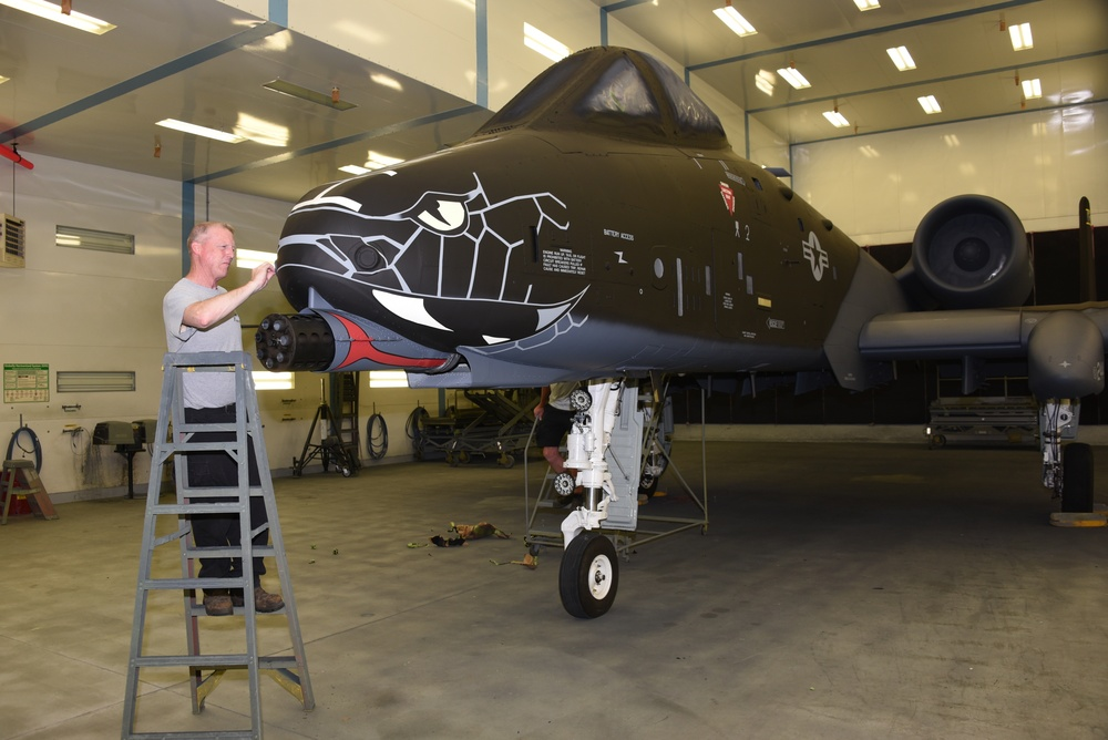 Cleaning up stenciling on a commemorative A-10