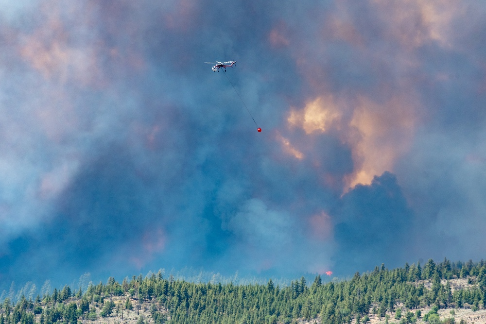 Helicopter drops water on the Beckwourth Complex Fire July 8, 2021 near Frenchman Lake in N. California