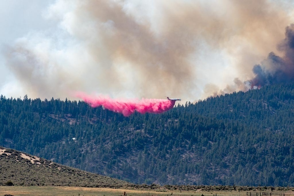 Air Tanker drops retardant on the Beckwourth Complex Fire July 9, 2021 near Frenchman Lake in N. California