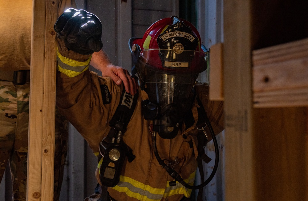 GOING IN BLIND AND LOW: 152nd CES Firefighters show off their confidence in SCBA confined space confidence course