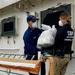 Coast Guard offloads $15 million in seized cocaine, transfers custody of 2 smugglers in San Juan, Puerto Rico