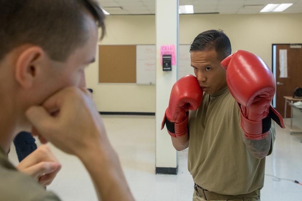 Capt. Adrian Mateos teaches a combatives course