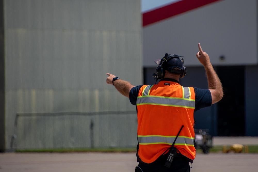 A CAL FIRE employee launches an Air National Guard C-130 from McClellan Air Tanker Base, Sacramento, Calif.