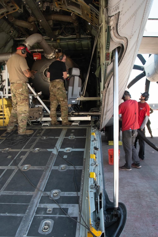CAL FIRE employees load retardant into an Air National Guard C-130 from McClellan Air Tanker Base, Sacramento, Calif.