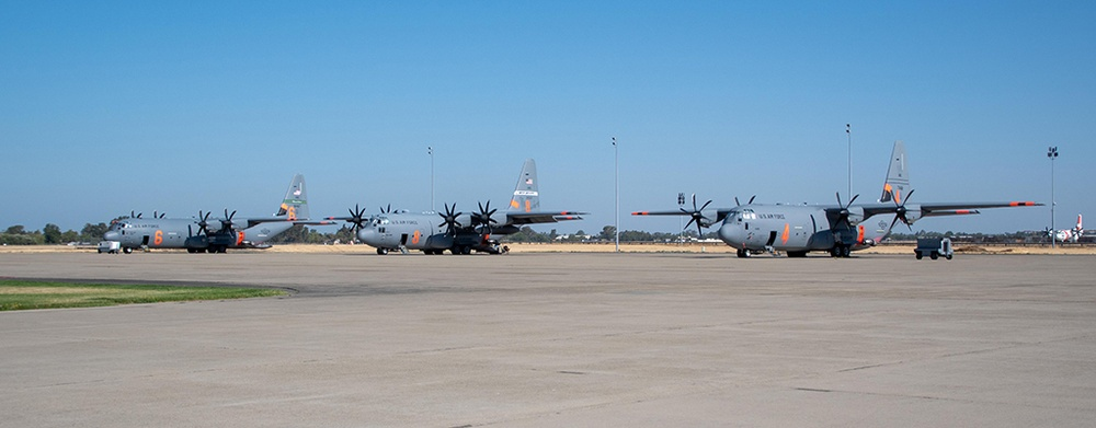Air National Guard C-130s, MAFFS 6, 8 and 4, await launch orders July 14, 2021 at McClellan Air Tanker Base, Sacramento, Calif.