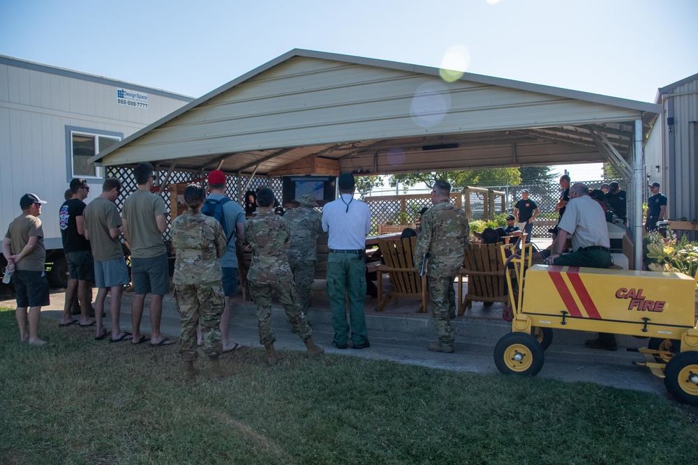 CAL FIRE and United States Forest Service employees, along with members of the Air National Guard attend the morning briefing at McClellan Air Tanker Base, Sacramento, Calif.