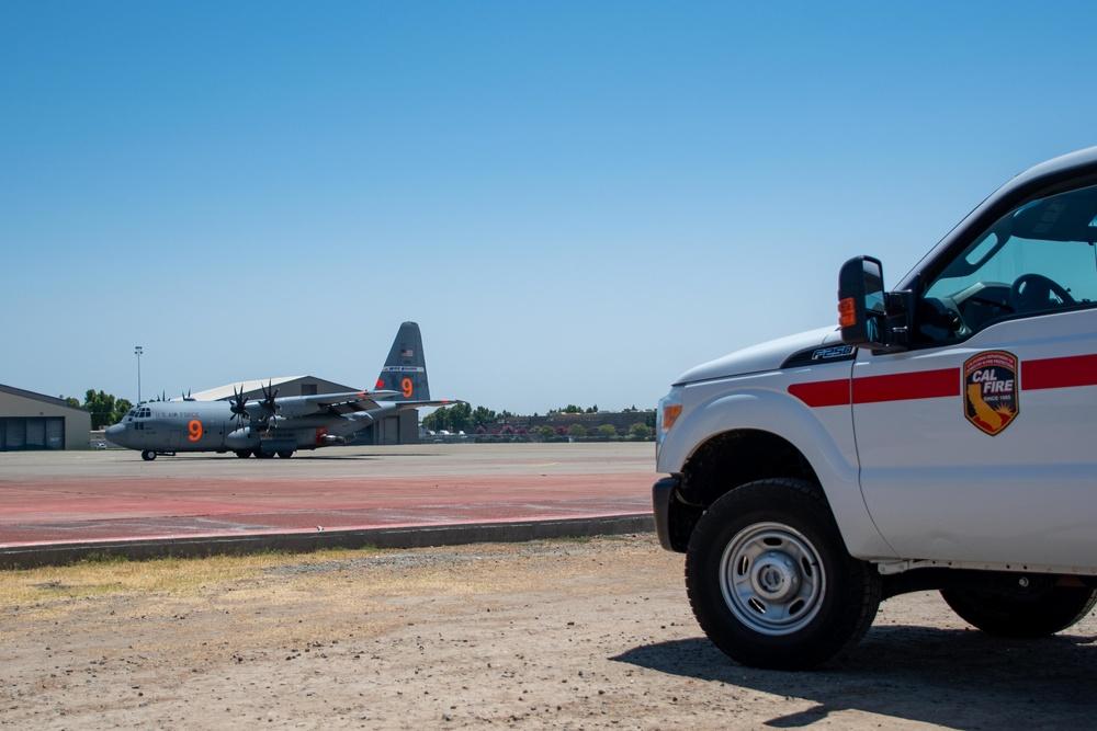 Air National Guard C-130, MAFFS 9 out of Reno, Nev. returns to McClellan Air Tanker Base, Sacramento, Calif.