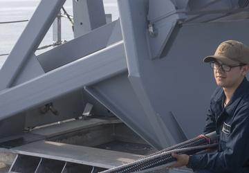 Sailor carries flagstaff