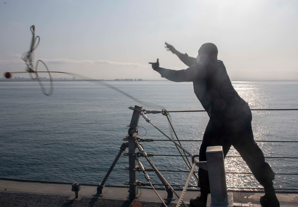 Sailor throws heaving lines