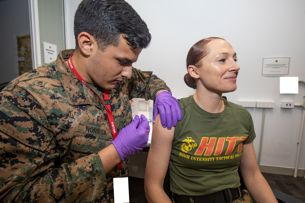 U.S. Navy Corpsmen with MRF-D administer influenza and COVID-19 vaccines