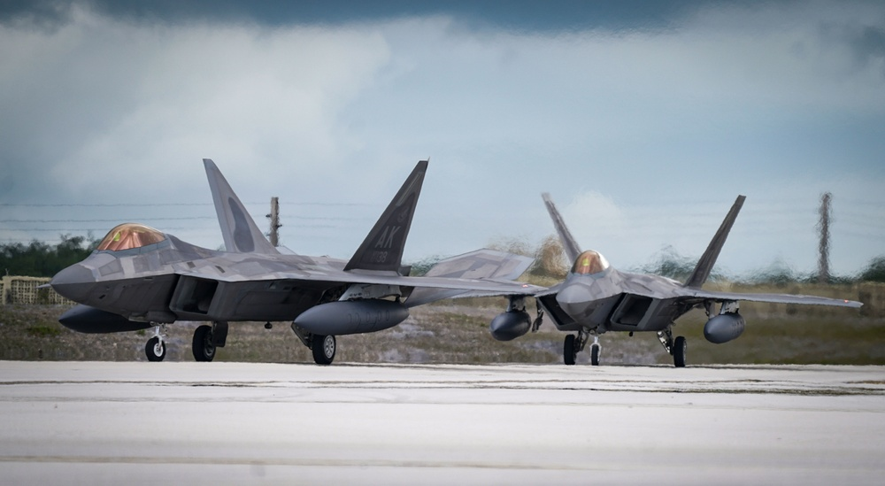 Alaska F-22s arrive on Guam for Pacific Iron 21