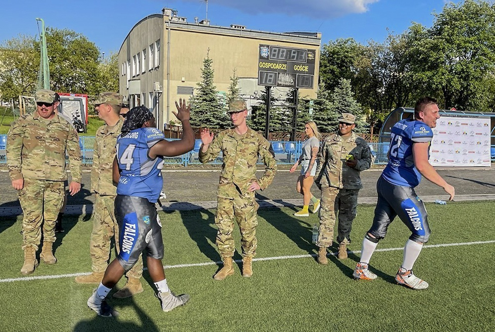 Deployed Soldiers represent US Army at football game in Poland