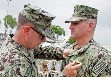 McClure awarded Navy Expeditionary Supply Corps Officer Warfare pin