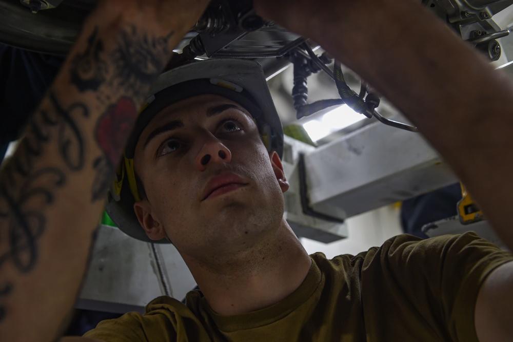 USS Carl Vinson Sailor Repairs Engine
