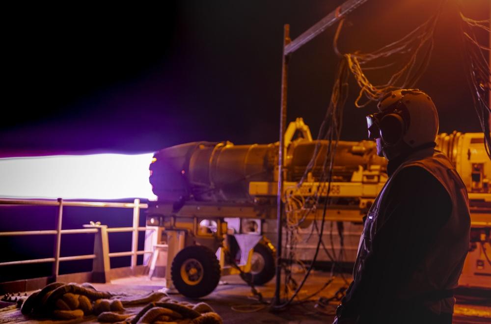 USS Carl Vinson (CVN 70) Sailor Observes Jet Engine Test