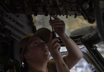 Helicopter Sea Combat Squadron (HSC) 23 Sailor screws bolt