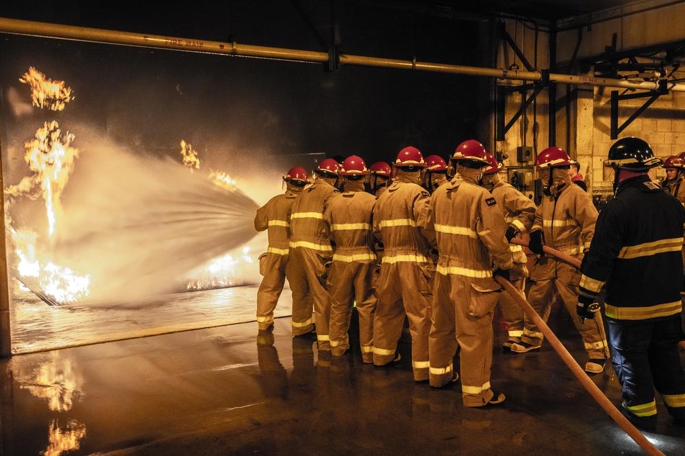 210714-N-NO485-0021 NEWPORT, R.I. (July 14, 2021) OCS class 15-21 extinguishes a controlled Class A fire