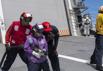 USS Jackson (LCS 6) Sailors fight simulated fire