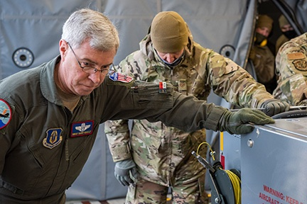 Senior Master Sgt. Barry Bradley, a boom operator from the 916th Air Refueling Wing, and Tech. Sgt. Michael Sizemore, an air transportation specialist from the 67th Aerial Port Squadron