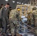 Tech. Sgt. Chris Davis, a boom operator from the 916th Air Refueling Wing, assists 67th Aerial Port Squadron reservists with locking a pallet down in a KC-46A Pegasus