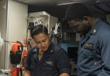 USS Jackson (LCS 6) Sailors perform spot check