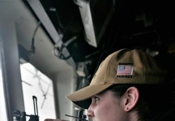 USS Lake Champlain (CG 57) sailor Takes Bearing on the Bridge