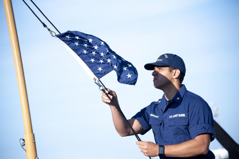 USCGC Brant Crew Member Posts Union Jack Flag