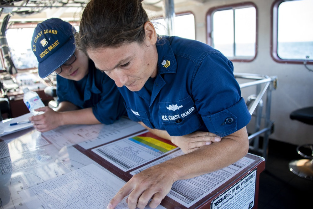 USCGC Brant Crew Members Review Charts